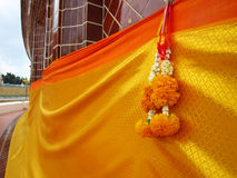 Yellow robe and flower garland Royalty Free Stock Images