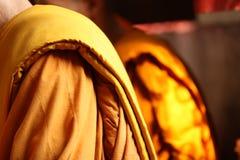 Yellow robe of thai monk Stock Photo
