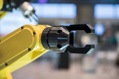 Yellow robotic arm  Royalty Free Stock Images