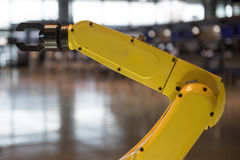 Yellow robotic arm  Stock Images