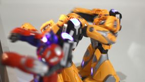 Yellow robots boxing. Close up of battle robot. Two robot fight. Fighting robots toy. Toy robot attack. Small robot fighting. Futuristic game concept stock footage