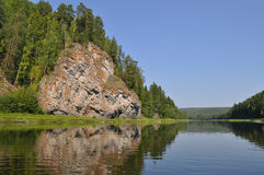 Yellow rock on the Chusovaya River Stock Images