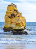 Yellow rock on sandy Praia da Rocha beach in Portimao and view of turquoise sea water, Portugal Stock Image
