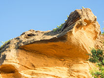 Yellow rock sediments. Stratification of yellow stone Stock Image