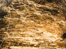 Yellow rock sediments. Stratification of yellow stone Royalty Free Stock Photography