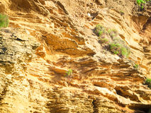 Yellow rock sediments. Stratification of yellow stone Royalty Free Stock Image