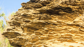 Yellow rock sediments. Stratification of yellow stone Royalty Free Stock Photo