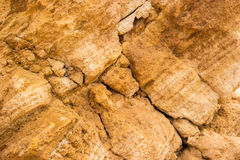 Yellow rock texture. Stones with cracks. Mother nature builds might. Place of geological research Stock Photography