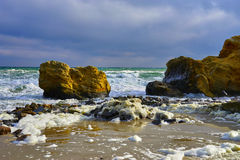 Yellow Rock in waves Royalty Free Stock Photography