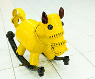 Yellow rocking horse Stock Photos