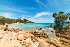 Yellow rocks in Capriccioli beach Royalty Free Stock Photo