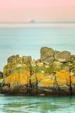 Yellow rocks on French coast, St-Malo, France Stock Image