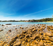 Yellow rocks on the shore in Sardinia Stock Photography