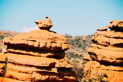 Yellow rocks in the South African Magaliesberg plateau. A group of fantastically nature shaped yellow rocks in the South African Magaliesberg plateau on a sunny Stock Image