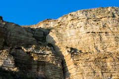 Yellow rocky cliff in layers Royalty Free Stock Photo