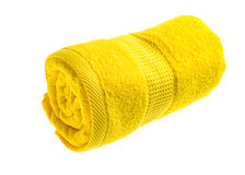 Yellow rolled towel. Isolated on white background stock photography