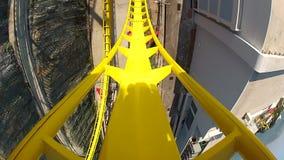 Yellow roller coaster beginning stock video footage