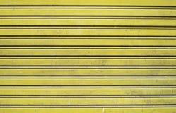 Yellow roller door Stock Photography