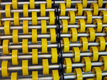 Yellow roller heap on metal tubes, industry details,. Yellow roller pile on metal tubes, modern industry details stock images
