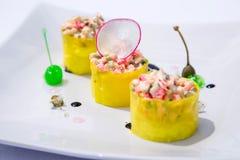 Yellow rolls salad. stock photos