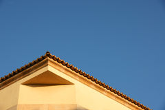Yellow roof and blue sky Royalty Free Stock Photos