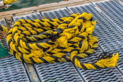 Yellow rope on dock. Images taken while on a Fishing trip in Bar Harbor Maine USA royalty free stock photo