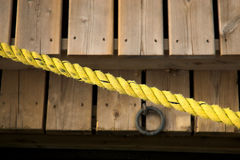 Yellow rope over docks. Yellow rope stretches over docks in harbour Stock Photography