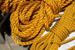Yellow rope in piles on the market. Stock Image