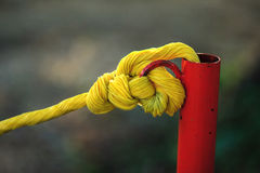 Yellow rope on red tube Royalty Free Stock Photography
