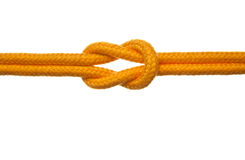 Yellow Rope with Reef Knot. A yellow rope tied with a reef or square knot. White Background Royalty Free Stock Image