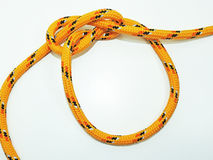 Yellow rope with some nodes. Stock Images