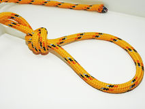 Yellow rope with some nodes. Stock Photos