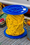 Yellow rope on spool. Images taken while on a Fishing trip in Bar Harbor Maine USA royalty free stock image