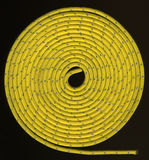 Yellow rope in tight coils. Tight coils of yellow, nylon rope with a silver reflective thread on black Stock Images
