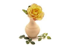 Yellow rose. With ceramic vase royalty free stock photos