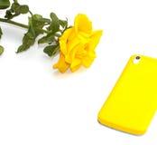 Yellow rose and beautiful phone Stock Photos