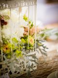 The yellow rose in the birdcage. On the wedding decoration Stock Photo