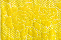 Yellow rose on blanket texture. The yellow rose on blanket texture Royalty Free Stock Images