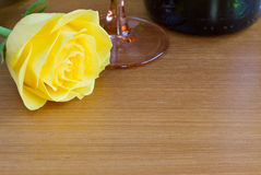 Yellow rose with a bottle of wine Stock Images