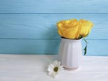 Yellow fresh rose vase border chrysanthemum anniversary wooden background frame nature greeting decoration birthday. Yellow rose fresh vase chrysanthemum wooden Royalty Free Stock Photo
