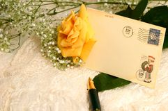 Yellow rose and postcard royalty free stock photos