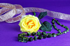Yellow rose with ribbon Royalty Free Stock Images