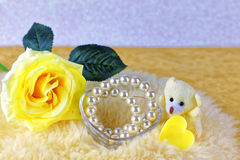 Yellow rose with ribbon Royalty Free Stock Photo