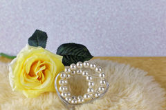 Yellow rose with ribbon Royalty Free Stock Image