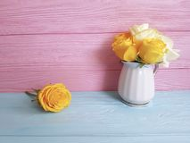 Yellow rose vase wooden background frame nature greeting decoration. Yellow rose vase wooden background elegant decoration greeting nature frame Royalty Free Stock Photo