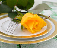 Yellow rose on a white plate Royalty Free Stock Photography