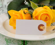 Yellow rose on a white plate Stock Photo