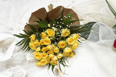 Yellow  rose on a white silk Stock Photography