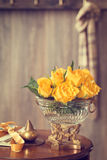 Yellow Roses. In antique vase sitting on hallway table Royalty Free Stock Photography