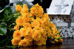 Yellow roses. Beautiful flowers in the bouquet Christmas. Christmas presents Royalty Free Stock Image